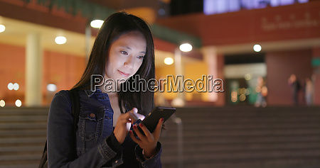 woman look at smart phone in