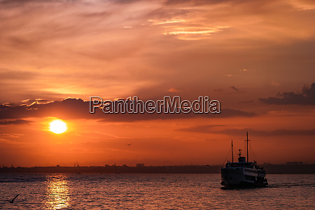 istanbul city lines ferry in sunset