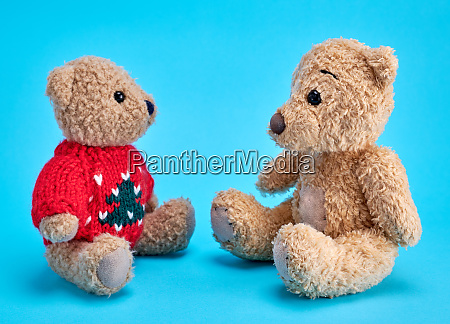 two teddy bears are sitting