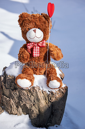 brown teddy bear sitting on a