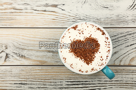 full white cup of cappuccino coffee