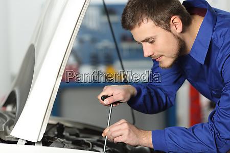 mechanic repairing a car in a
