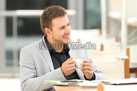 pensive executive in a coffee shop