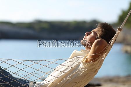man relaxing on a hammock in