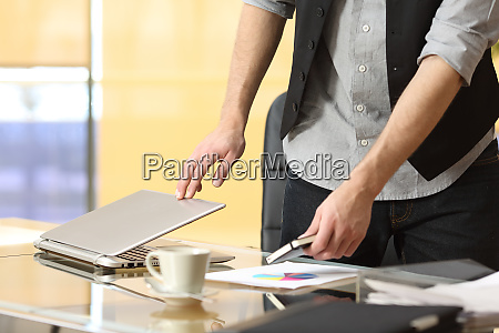businessman leaving work at office