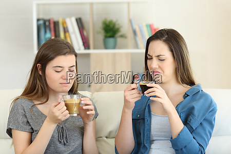 two friends drinking coffee with bad
