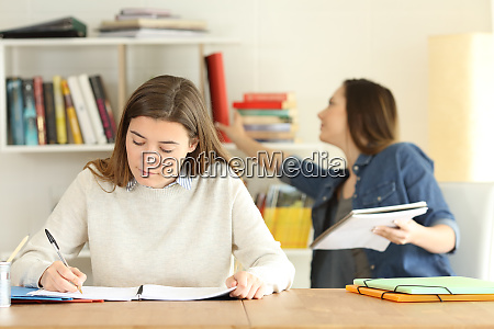 two college students studying at home