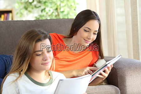 students learning on a couch at