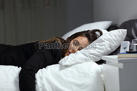 tired businesswoman lying on a bed