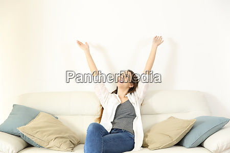 happy woman raising arms and looking