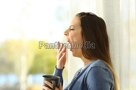profile of a woman yawning in