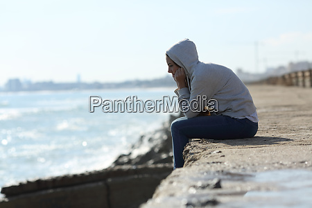 sad teenager girl alone on the