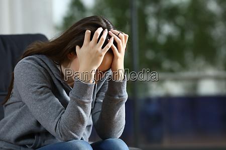 sad woman complaining alone on a