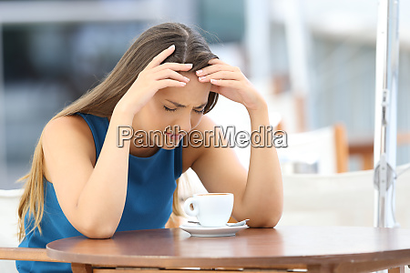 sad woman complaining in a coffee