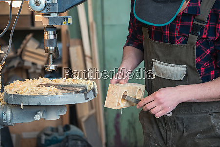carpenters with electric drill machine drilling