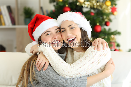 friends cuddling on christmas day at