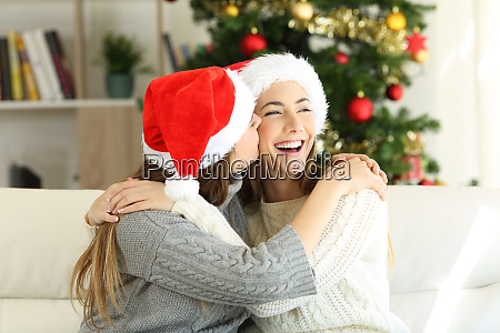 friends kissing on christmas day at