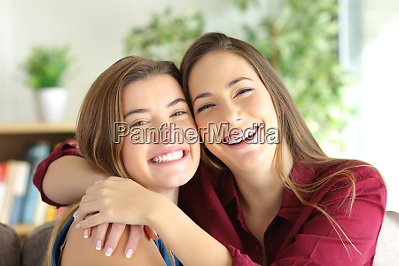 friends or sisters smiling and posing