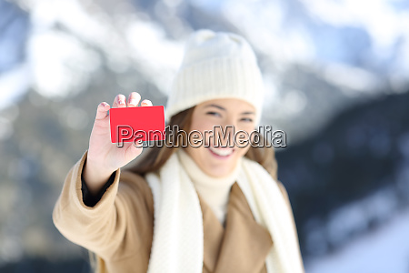 happy woman showing a credit card