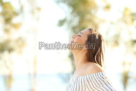happy woman breathing fresh air outside