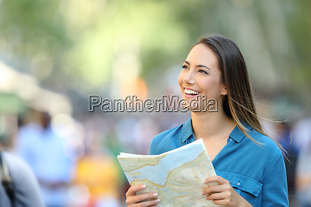 happy tourist sightseeing holding a guide