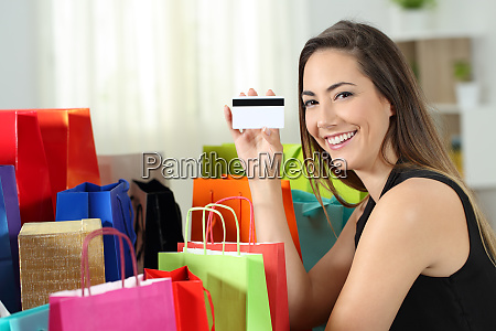 happy shopper showing a credit card