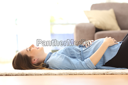 pregnant woman resting on the floor