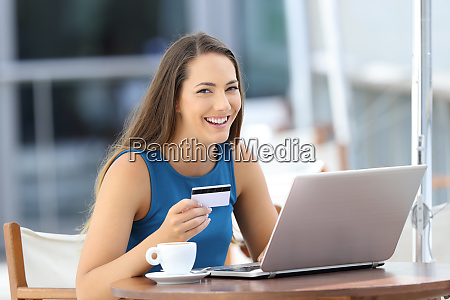 happy buyer holding a credit card