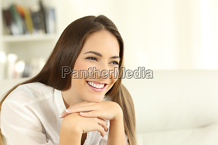 woman with perfect teeth smiling at