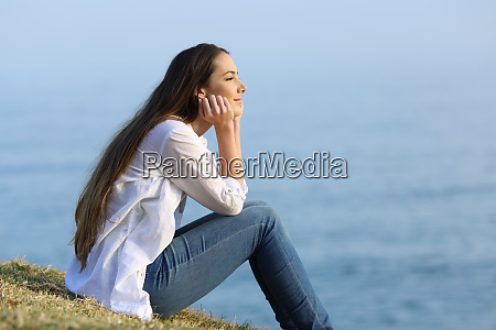 woman relaxing sitting on the grass