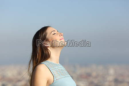 woman breathing fresh air with a