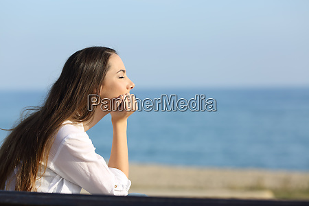woman relaxing mind on the beach