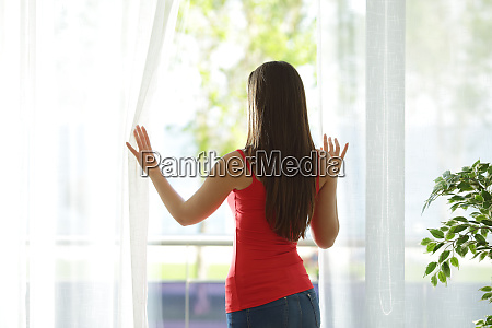 woman looking through a window at