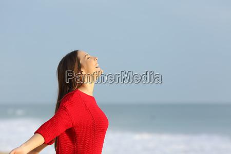 woman in red breathing fresh air