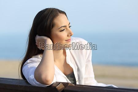 pensive satisfied woman looking away on