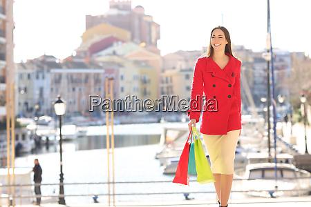 shopper walking towards camera in winter