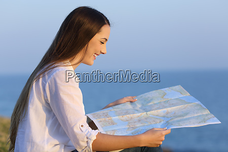 profile of a tourist consulting a