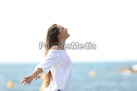 relaxed woman breathing fresh air on