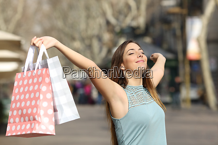 shopper holding shopping bags in a