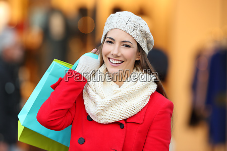 shopper holding shopping bags looking at