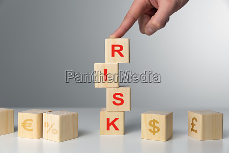 hand hold wooden cubes with risk