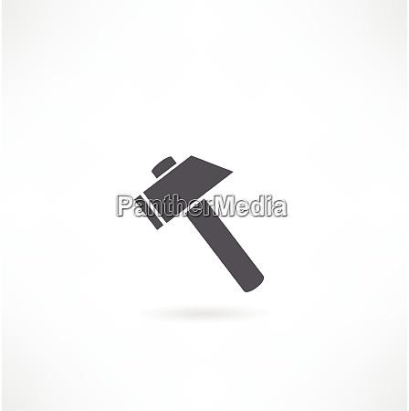 martillo silueta sobre un fondo blanco