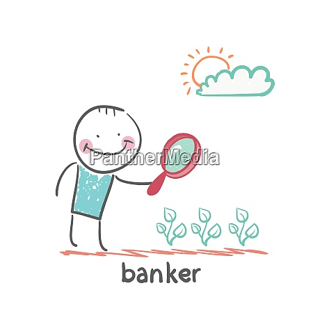 banker is looking through a magnifying