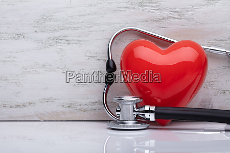 stethoscope with red heart on white