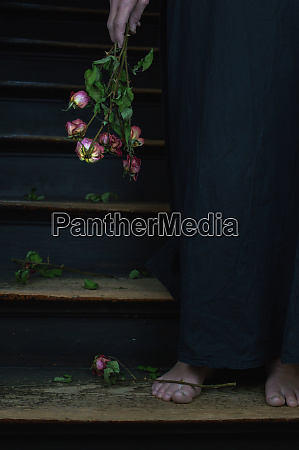 a woman holding a bouquet of