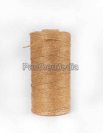 coiled brown rope on white background