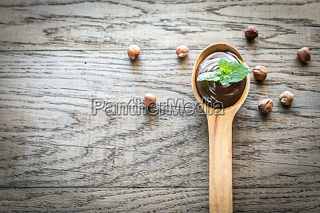 wooden spoon of chocolate cream with