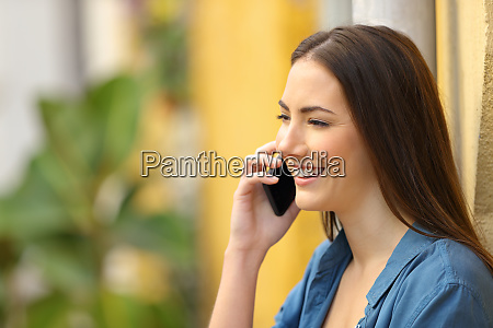 woman smiling talking on phone in