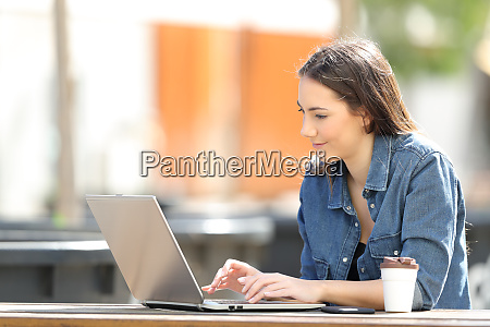 serious woman using a laptop on