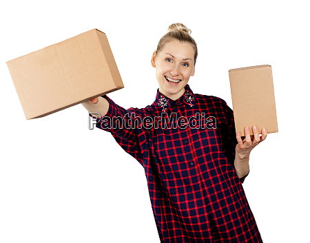 woman holding blank cardboard boxes in